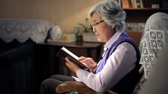 A elderly Christian reading book