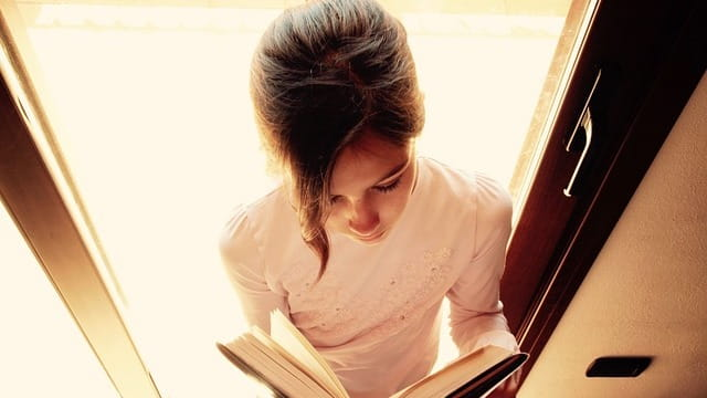 A girl reading book