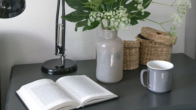 A book and a cup on the table, reading book