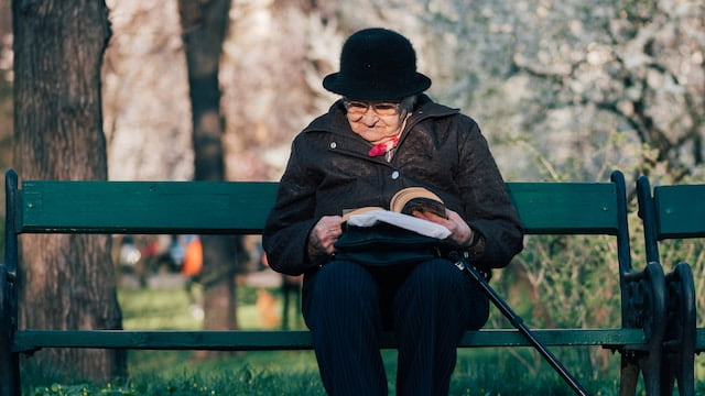 Miracle Testimony,old woman sitting on desk and reading book